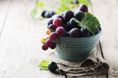 Red sweet grape on the wooden table Stock Photography