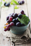 Red sweet grape on the wooden table Royalty Free Stock Photos