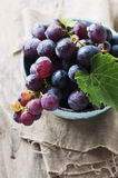 Red sweet grape on the wooden table Stock Photos