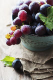 Red sweet grape on the wooden table Stock Photo