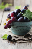 Red sweet grape on the wooden table Stock Images