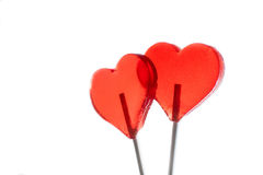 Red sweet hearts on white background. Lollipop Royalty Free Stock Photo