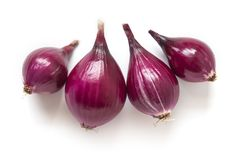 Red sweet onion bulbs on white stock photo