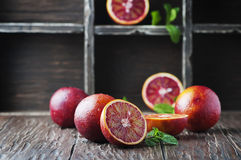 Red sweet oranges on the wooden table Royalty Free Stock Images