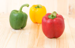Red sweet peper on wooden background Royalty Free Stock Photo