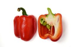 Two half of a bright red raw washed with green tail bulgarian sweet pepper isolated on white background stock images