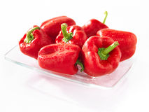 Red sweet pepper on a glass plate. And white background Stock Photos