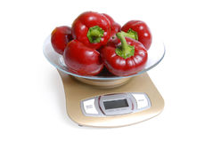 Red sweet pepper on scales Royalty Free Stock Photography