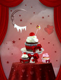 Red sweets. Valentine cupcakes in afantasy scenery Royalty Free Stock Photography