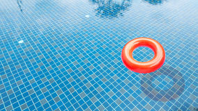 Red swim ring. In the swimming pool Stock Photo