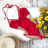 Red swimsuit on the background of fur royalty free stock photo