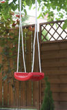 Red swing outdoors Stock Images