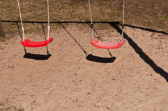 Red swings Stock Images