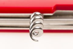 Red swiss army knife isolated, focus on corkscrew Stock Photo