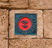The red symbol  a smile. The red symbol on the wall of a smile Stock Photography