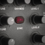 Red Syncronization Knob. Red knob of synchronization on the electronic musical instrument, macro shot with selective colour Royalty Free Stock Images