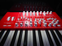 Red Synthesizer with reflection on black background Stock Images