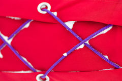 Red synthetic fabric and cords Stock Photo