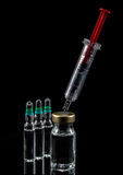 Red syringe Stock Photo