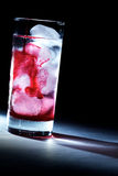 Red syrup in spot light Royalty Free Stock Images