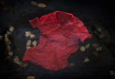 Red t-shirt floating  in water. Red t-shirt floating or sinking in water Stock Photography