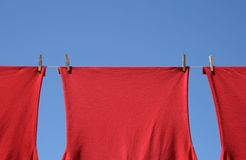 Red t-shirts on a clothes-line Royalty Free Stock Photography