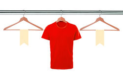 Red t-shirts on hangers and blank tags isolated on white backgro Royalty Free Stock Photography