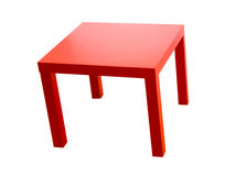 Red table. Modern red table isolated on white background stock photo