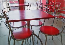 Modern furniture. Red table and chair at a restaurant stock photo