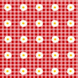 Red table cloth with chamomiles Stock Photo