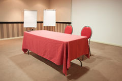 Red table in empty conference room Royalty Free Stock Photo