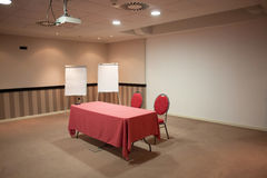 Red table in empty conference room Royalty Free Stock Images