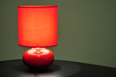 Red table lamp Stock Images