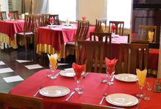 Red table at restaurant. Restaurant interior with red and beige tablecloths stock photos