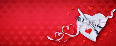 Red Table Setting Cutlery With Heart Decoration Royalty Free Stock Photography