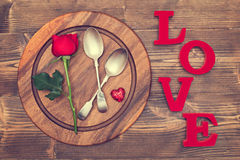 Red Table Setting. Valentine's Day table setting with red rose Royalty Free Stock Images