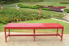 Red table. With white garden background Royalty Free Stock Photos