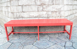 Red table. With white rock background Stock Images