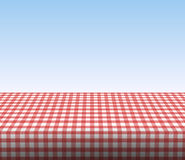 Red tablecloth. Red checkered realistic tablecloth a sunny scenery Royalty Free Stock Image