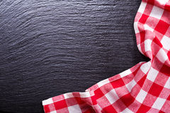 Red tablecloth on dark desk Stock Photos