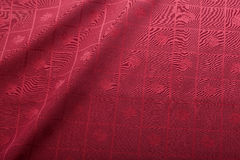 Red tablecloth. Folded red tablecloth with a cells decoration Royalty Free Stock Photography