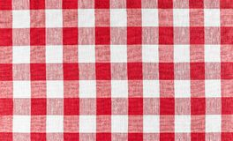 Red tablecloth. Red checkered picnic tablecloth photo Royalty Free Stock Image