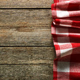 Red tablecloth. On rustic background Stock Images