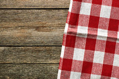 Red tablecloth. On rustic background Royalty Free Stock Images