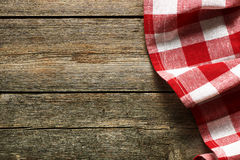 Red tablecloth. On rustic background Royalty Free Stock Photos