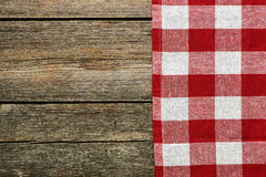 Red tablecloth. On rustic background Royalty Free Stock Photography