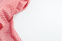 Red Tablecloth textile on white background. With place for your text Stock Images