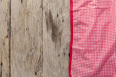 Red tablecloth textile on wooden background. Stock Photography