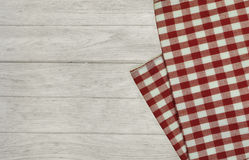 Red tablecloth on white wooden table. Royalty Free Stock Images