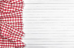 Red tablecloth on white wooden table, top view Royalty Free Stock Image